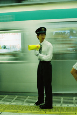 japan personal project moments in between train conductor yellow megaphone tokyo