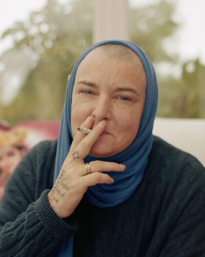 Portrait of Sinead OConnor at home smoking a cigarette