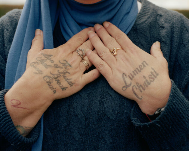Portrait of Sinead OConnor at home close up of the tattoos on her hands