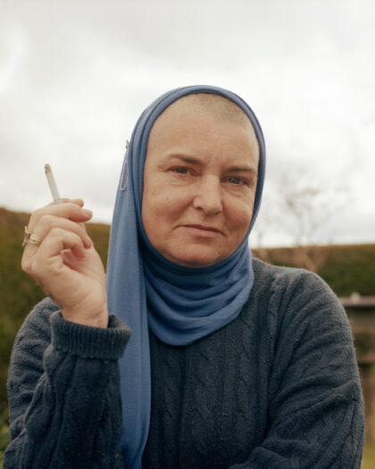 Portrait of Sinead OConnor at home in her garden holding a cigarette