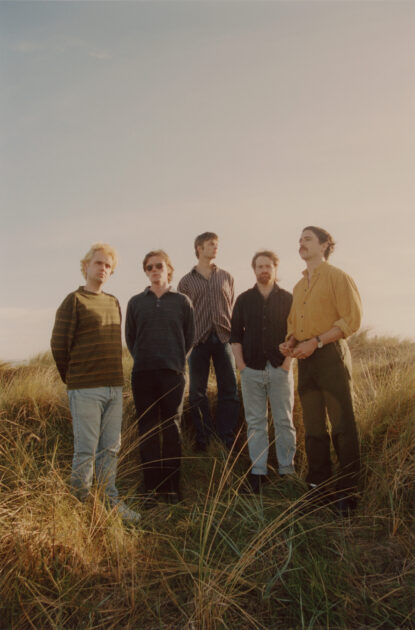 Press photo for Dublin band Fontaintes DC, standing in dunes on Bull Island